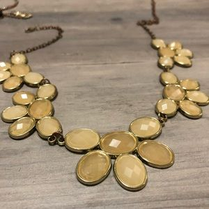 Cream color costume necklace with gold accents